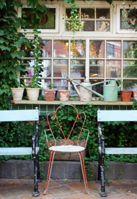 Backyard Decoration with Pots, Pans and a Chair