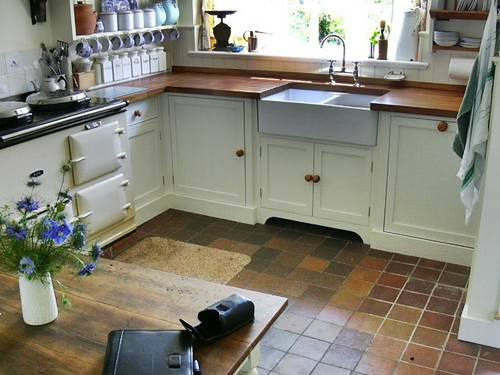 A Cute Cottage Kitchen U2013 Look At The Neat Row Of Jars In The Corner, The  Aga Stove, Tiled Floor And Fresh Flowers On The Table U2013 Photo By Paul Flint  ...
