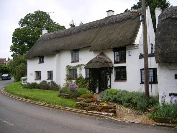 A Lovely English Country Home with a Thatched Roof