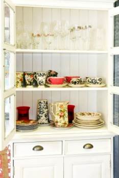 Pretty Floral China Patterns Vintage Crockery in a Cabinet