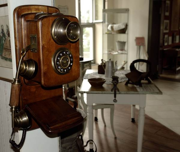 A Wooden Vintage Telephone on a Room Wall